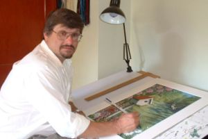 Larry Smail at drawing board