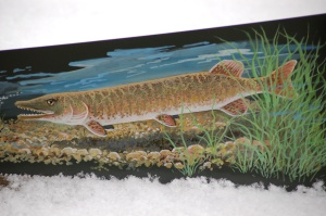 Detail of the muskie and the saw blade. Laurie told everybody I had painted a guppy!